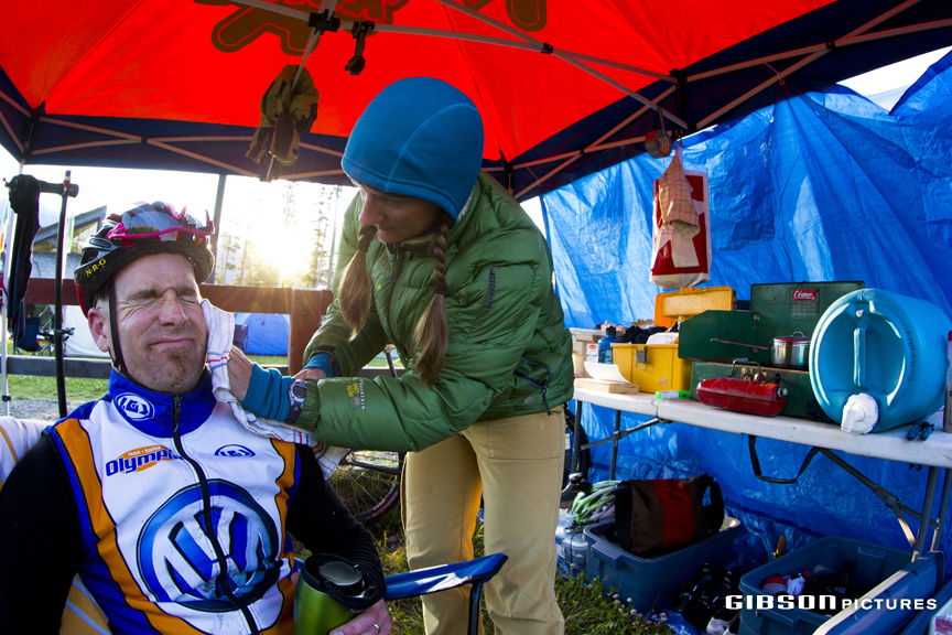 Canmore 24 Hours of Adrenaline Solo Winner Patrick Hummeny gets a face wipe from wife Naomi Sunday morning in between laps. John Gibson photo
